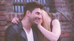 Girl Whispers in Guys Ear Stock Footage