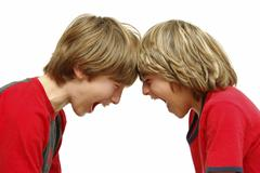 Boys shout each other Stock Photos