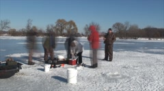 Ice fishing in time lapse 2 Stock Footage
