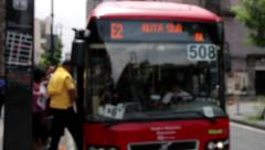 Bus stop blurred image, a bus arrive and open the door. Stock Footage