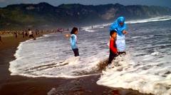 Kids Playing on the Beach Stock Footage