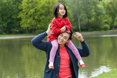 asian dad and daughter - stock photo