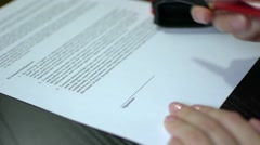 Contract Signing Close Up Of A Woman's Hand With Pen Stock Footage