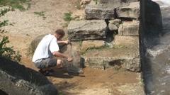 Man catch gar fish by net 2 Stock Footage