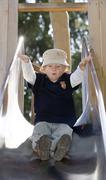 A three year old boy on a slide Kuvituskuvat