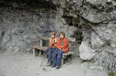 Stock Photo of two boys sitting at the exit of the gorge partnachklamm near partenkirchen, u