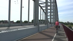 Cyclists using the cycle lane crossing the John Frostburg, Arnhem, Netherlands. Stock Footage