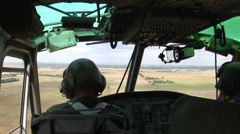 Veteran pilots pilot a Huey helicopter Stock Footage