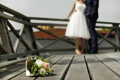 Bridal bouquet with bride and groom Stock Photos