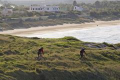 two mountainbiker riding a single trail in gargano, apulia, italy - stock photo
