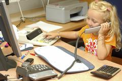 Little girl working in office Stock Photos
