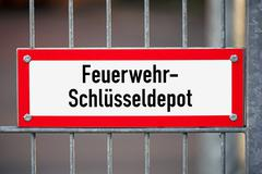 Stock Photo of sign for a key depot of the fire departement on a public building