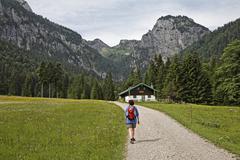hiker at alpine hut in längental valley , upper bavaria, germany - stock photo