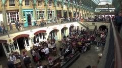 A restaurant area in one of the sunken wells in Covent Garden, London, UK Stock Footage