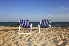 Two couches on the beach of hammamet, tunisia Stock Photos