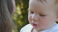 HD1080p25 Face of young baby (10 months old) happy in a mother´s hands - stock footage