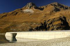 Water dam with overflow protection, moiry, valais, switzerland Stock Photos