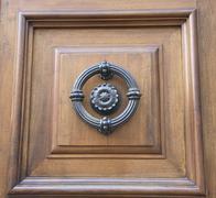 Old wooden door with handhold Stock Photos