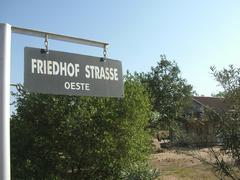 street sign in mixed german and spanish language in front of a house of the p - stock photo