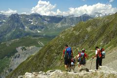 Alpinists return from the peak to valley, savoie alps france Stock Photos