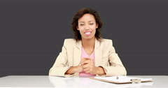 Businesswoman talking to the camera Stock Footage