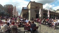Covent Garden,Market, London. Visitors enjoy eating and drinking  in The Piazza - stock footage