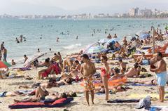 big hustle on the playa de palma beach, el arenal, majorca, balearic islands, - stock photo