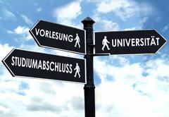 Direction sign, symbolic for university, final degree and lecture Stock Photos