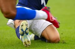 Foul at a soccergame, soccerplayer getting fouled Stock Photos