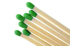 Matches with green match heads on white background Stock Photos