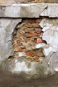 Brick through cracks and fissures Stock Photos