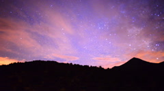 Time Lapse Pan of Mountain Range at Night Stock Footage
