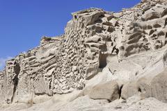 Bizarrely formed tuff rocks overtower the beach ormos vlichada, vlichada, san Stock Photos