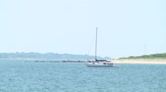 A lone sailboat anchored off napatree point, ri in summer Stock Footage