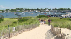 People walking onto napatree point, ri in summer Stock Footage