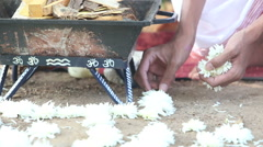 Brahmin lays flowers at the Indian ceremony Stock Footage