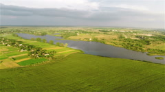 Flying Over River And Fields Stock Footage