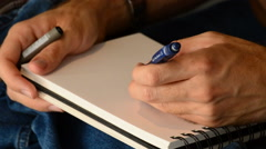 Sketcher drawing in a book with a pencil Stock Footage