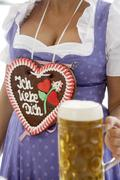 women, decollete, gingerbread heart, beer, tradition, traditional costume - stock photo