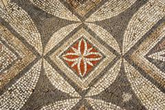 Colourful mosaic floral and geometric pattern at archaeological site of early Stock Photos