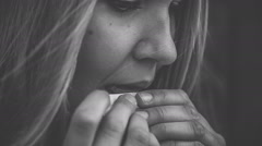 Woman licking cigarette rolling paper Stock Footage