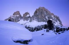 Stock Photo of dawn at mt. langkofel aka mt. sasso lungo in winter, dolomites, bolzano-bozen