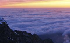 Stock Photo of view over a sea of clouds, mount zugspitze, pink evening light, bavaria, germ