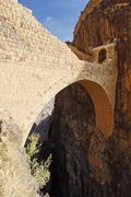 historic stone bridge in shahara, yemen, arabia, arabian peninsula, middle ea - stock photo