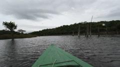 Canoe on Amazon backwater 3 Stock Footage