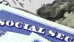 Social security card and US currency one hundred dollar bill Stock Footage