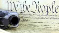US Constitution with Hand Gun Stock Footage