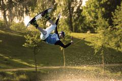 Wakeboarder at a water ski facility. Stock Photos
