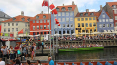 People boarding Canal tour boats in Nyhavn Copenhagen Stock Footage