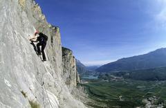 Stock Photo of woman climbing the via ferrata che guevara, sarche, trentino, italy, europe